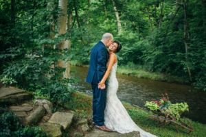 Image of wedding couple near river