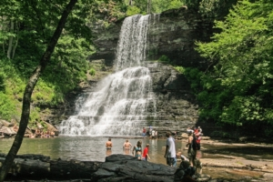 Image of a waterfall with people nearby