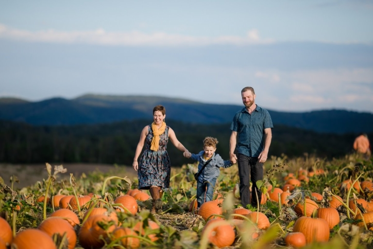 Image of family walking in pumpkin patch